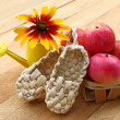 Summer still life with decorative sandals made of bark and small — Stock Photo