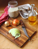 Frozen fish, rice groats and onions. Ingredients for lean dinner — Stock Photo