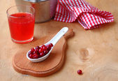 Fresh drink from a cranberry. — Stock Photo