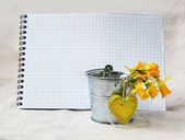 Page of notebook and bouquet of narcissuses — Stock Photo