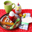 Easter breakfast with an egg, pie and card for a guest - Stock Photo