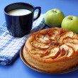 Royalty-Free Stock Photo: Homemade apples cake and dark blue cup with milk