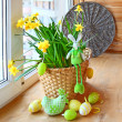 Narcissus with an happy easters rabbit and egg on a window — Stock Photo