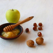 Autumn Still Life with honey, green apple and nuts - Stock Photo