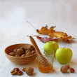 Autumn Still Life with honey, green apples and nuts on old table — Stock fotografie