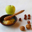 Autumn Still Life with honey, green apple and nuts — Stockfoto