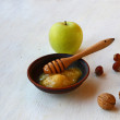 Autumn Still Life with honey, green apple and nuts — Stock Photo