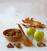 Autumn Still Life with honey, green apples and nuts on old table — Stock Photo