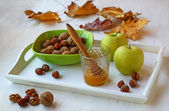 Apples, honey and nuts on a white tray — Stock Photo