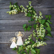 Beautiful lilac flowers on table and a handmade two decoration ang — Stock Photo
