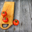 Red tomato on vintage table — Foto de Stock