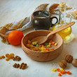 Candied fruits, nuts, olive oil and flour on a cook-table. Ingre — Stock Photo