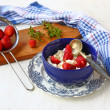 Stock Photo: Breakfast with a fresh strawberry with curd in dark blue a bowl