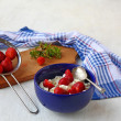 Washed strawberry in a colander and bowl with curd and berries — Stock Photo