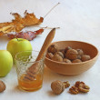 Autumn Still Life with honey, apples and nuts on old table — Stock fotografie