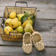 Fresh pears with weaved deco boots — Stock Photo