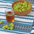 Glass with drink of hops and branch of hops — Stock Photo #34997543