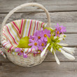 A bouquet of hosta and cosmos in a basket — Stock Photo