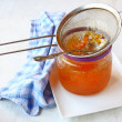 Strain it through a sieve quince jelly — Stock Photo