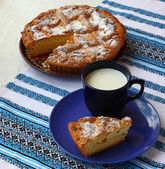 Homemade pie with curd and cup with milk — Stock Photo