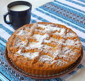Curd pie and cup with milk — Stock Photo