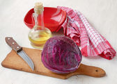 A head of red cabbage and a bottle of oil — Stock Photo