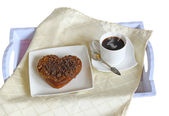 Baking in the shape of heart and a cup of coffee — Stock Photo