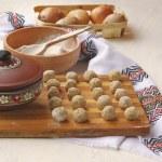 Meat dumplings on the kitchen board — Stock Photo #35284301