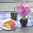 Strudel with apples and cup of tenext to bouquet of cosmo — Stock Photo #35978859