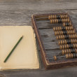 Retro abacus, pencil and notepad — Stock Photo