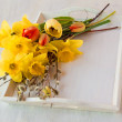 Easter bouquet on a white tray — Stock Photo