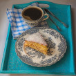 Stockfoto: Portion biscuit with coconut on vintage English plate