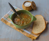 A bowl of lentil soup with a bread and salt — Stock Photo