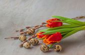 Easter eggs with  bouquet of  tulips and willow twigs — Stock Photo