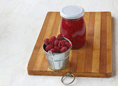 Raspberry on a background of jars of jam — Foto de Stock