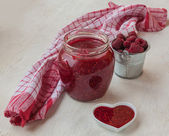Grinded raspberries with sugar and berries near the towel — Stock Photo
