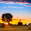 End of day over field with hay bale in Hungary — Stock Photo