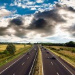 Highway traffic on  summer day - Foto Stock