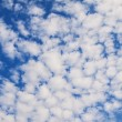 Amazing cumulus cloud formation in deep blue sky - Stok fotoğraf