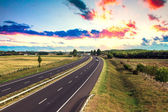 Highway traffic on summer day — Stock Photo