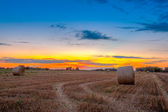 End of day over field with hay bale in Hungary- this photo made — Stock Photo