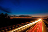 Cars speeding on a highway — Stock Photo
