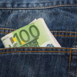 Euro banknotes in jeans back pocket — Stock Photo