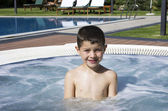 Child having a bath in a jacuzzi ( hotel Resort ) — Stock Photo