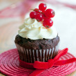 Chocolate and red berry cupcakes — Stock Photo