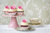 Afternoon tea with rose cupcakes — Stock Photo