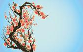 Vector fondo con ramas de flores contra un cielo azul — Vector de stock