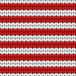 Vector seamless background. Knitted fabric with white and red stripes — Stock Vector #23456788