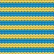 Vector seamless background. Knitted fabric with blue and yellow stripes — Stock Vector #23507471