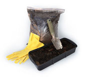 Gardening trowel, gloves, bag with peat, container for seedlings — Stock Photo